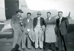 """Hustling """"Jack"""" Cornwall (all Johns were Jacks in '50s Queensland), secretary-manager of the Queensland University boxing team. Boarding an Ansett DC3 at Essendon airport after another series of knock out wins on the intervarsity circuit. August 1954."""